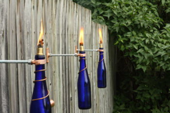 Wine bottle tiki torch stands