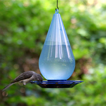 12 bird feeder ideas from milk jug inhabit zone. Black Bedroom Furniture Sets. Home Design Ideas