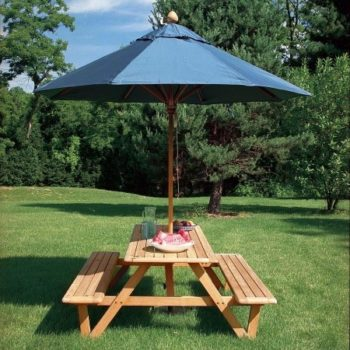 Wooden picnic tables with umbrella
