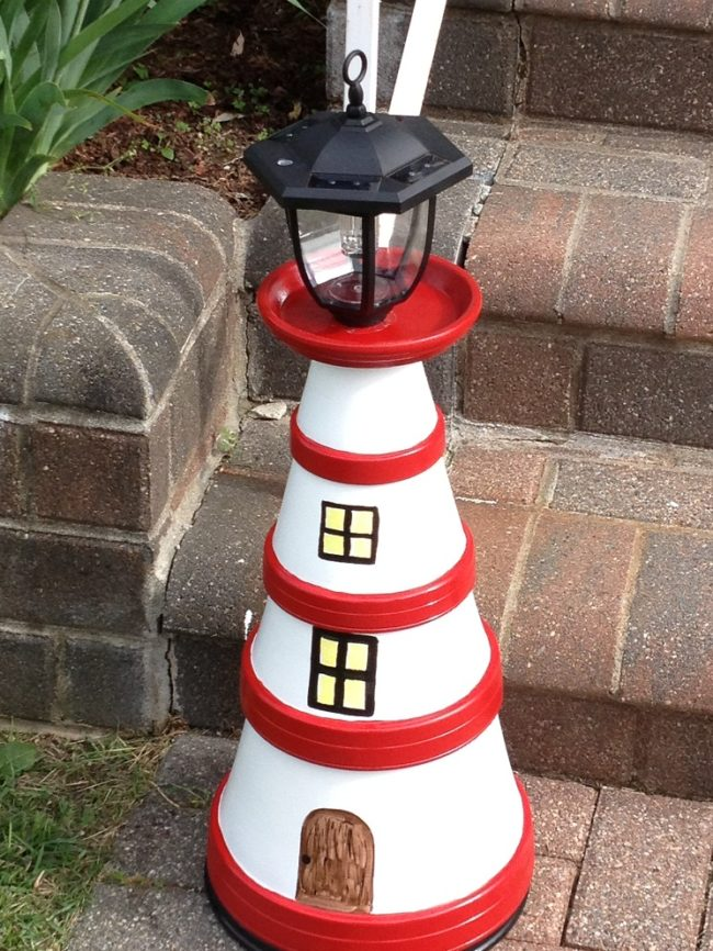 lighthouse made out of flower pots